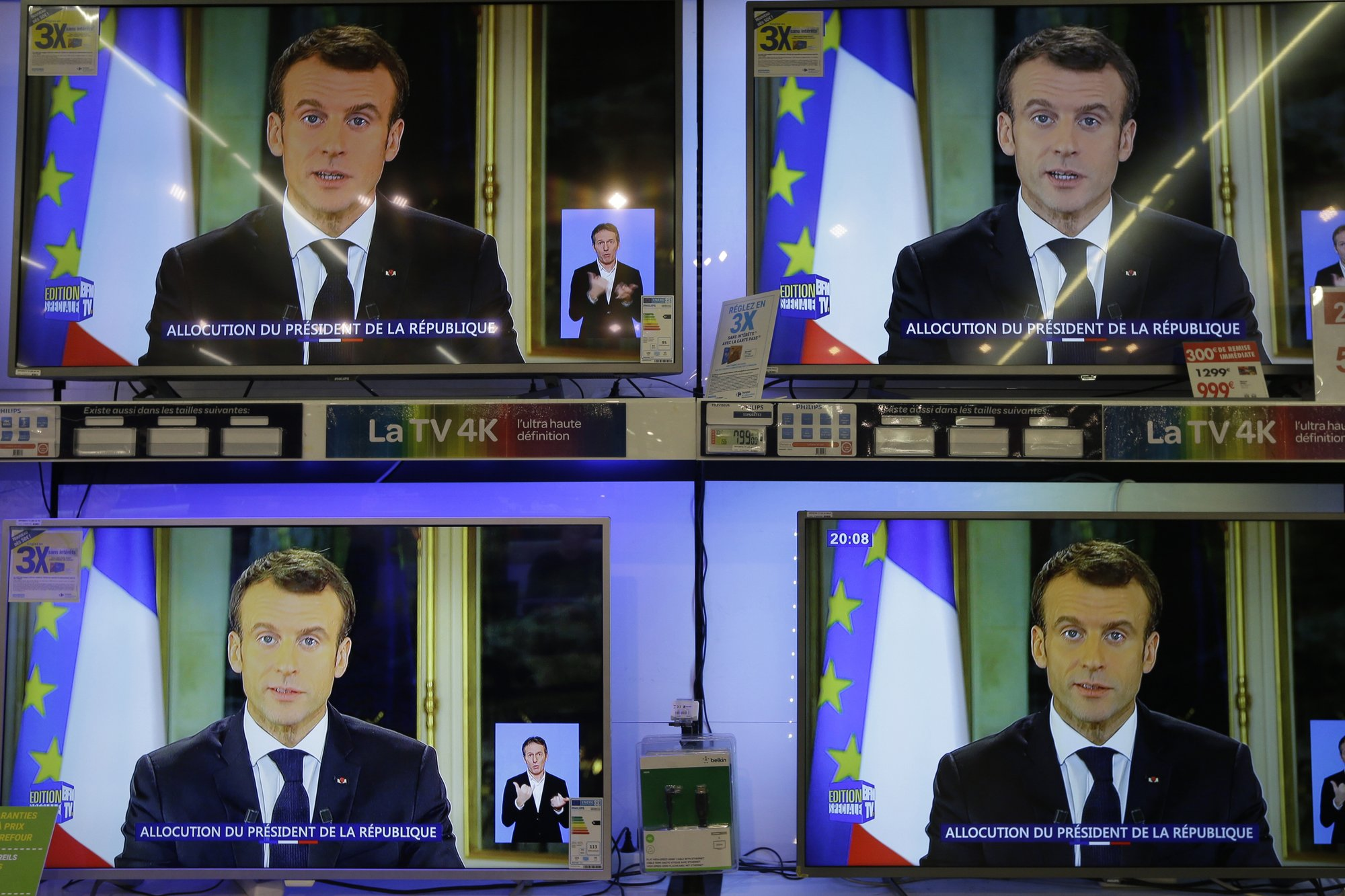 Macron vows tax cuts, pay rise; will France's anger subside?