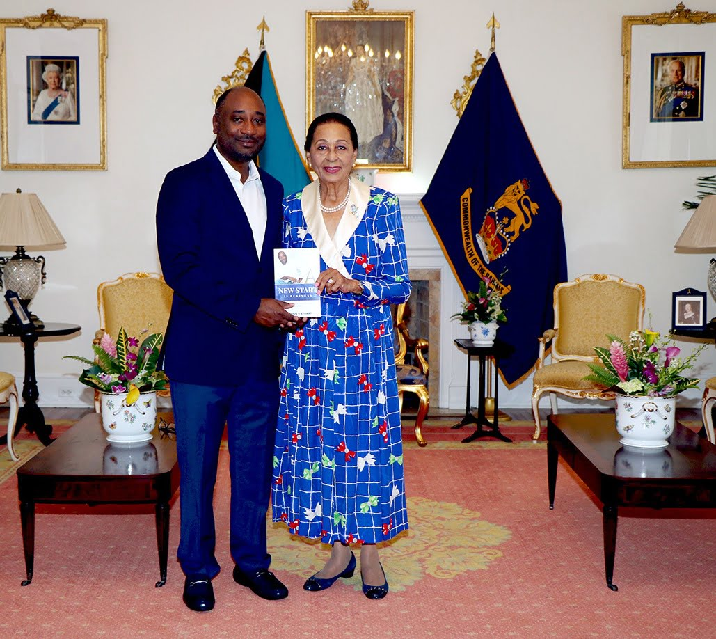 Cassius Stuart presents a copy of his book to the Governor General