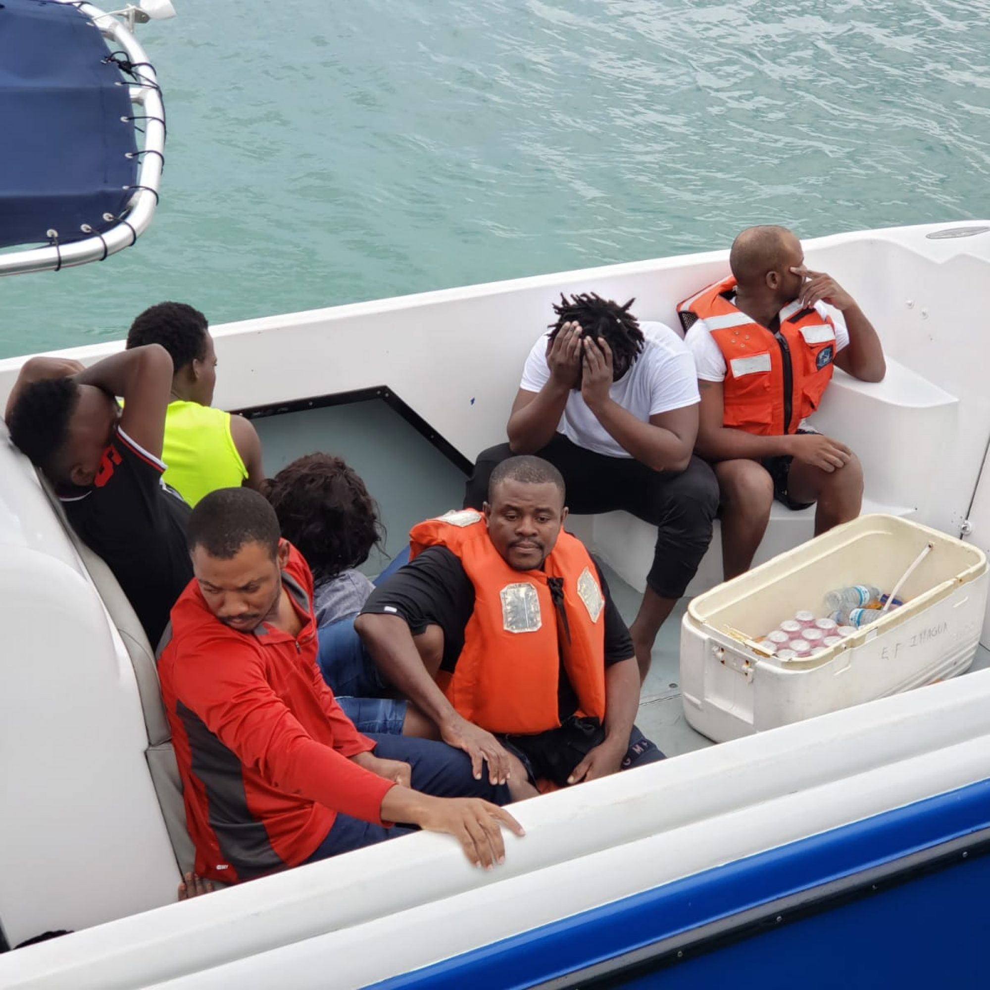 12 migrants rescued at sea, search continues for others