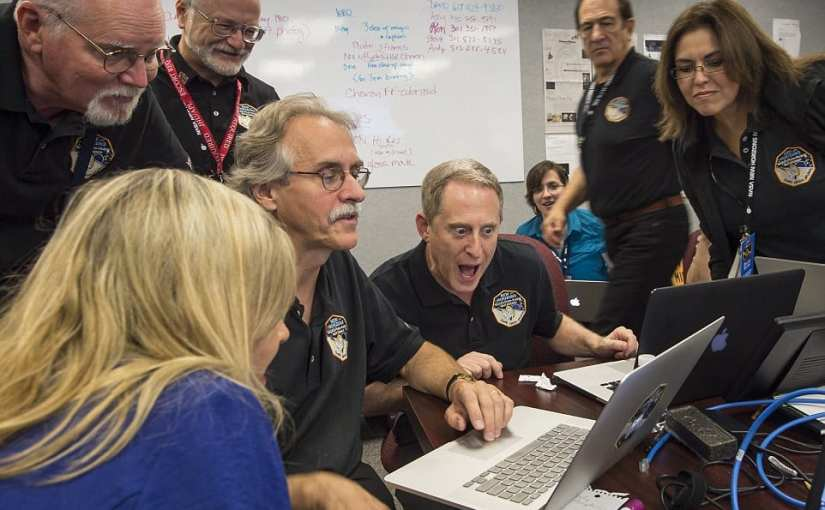 New Horizons principal investigator Alan Stern of Southwest Research Institute (SwRI), center, has described the images as 'mind blowing'. Pictured is his reaction at seeing the new images from the spacecraft for the first time, earlier today