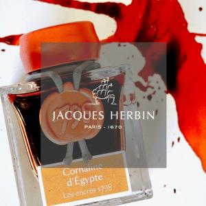 Jacques Herbin Logo in front of ink bottle