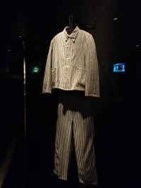 Entrants to the concentration camps had their clothes and belongings confiscated, and made to wear identical striped uniforms.