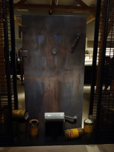 Model of a gas chamber door at Auschwitz. The prisoners were shepherded into chambers that looked like shower facilities. Zyklon B pellets were dropped into the vents to release the hydrogen cyanide.