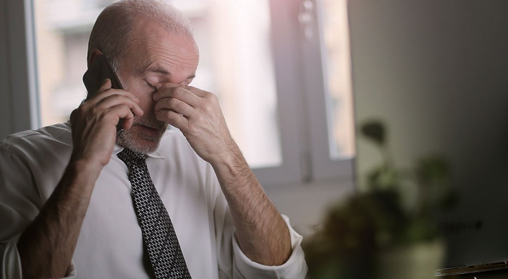 Image of a man complaining over the phone