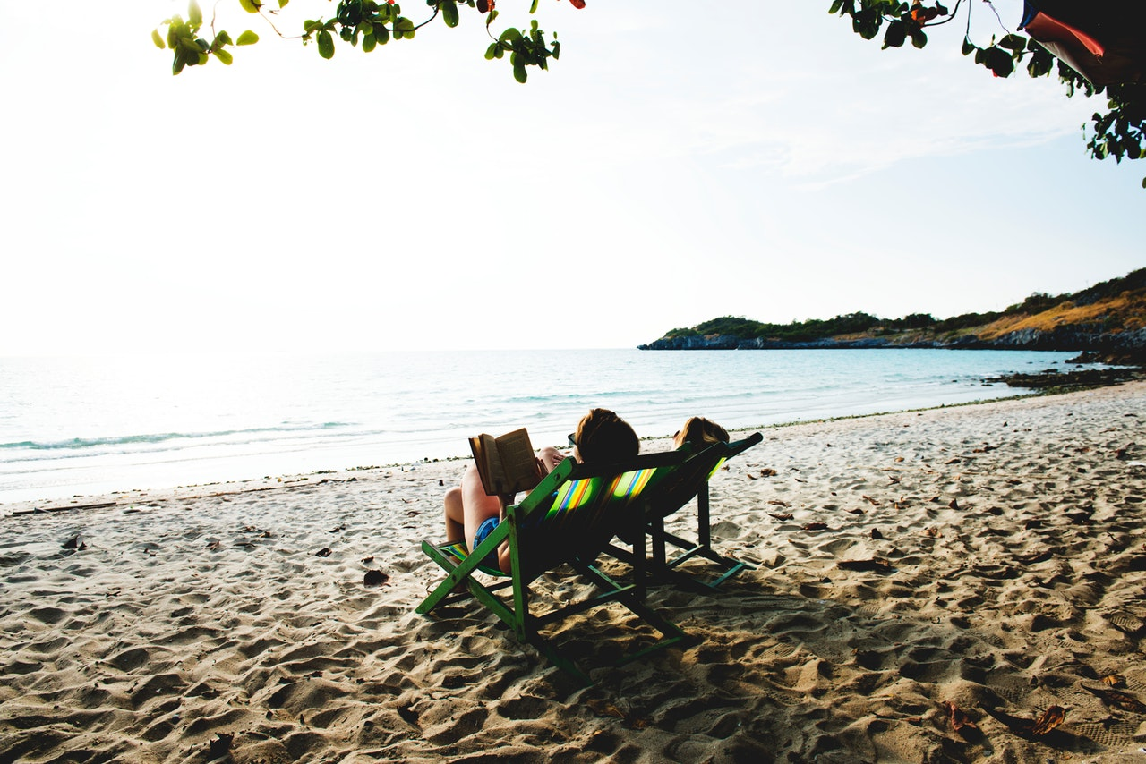 Image of someone relaxed and reading on a beach - is your business ready for your freedom?