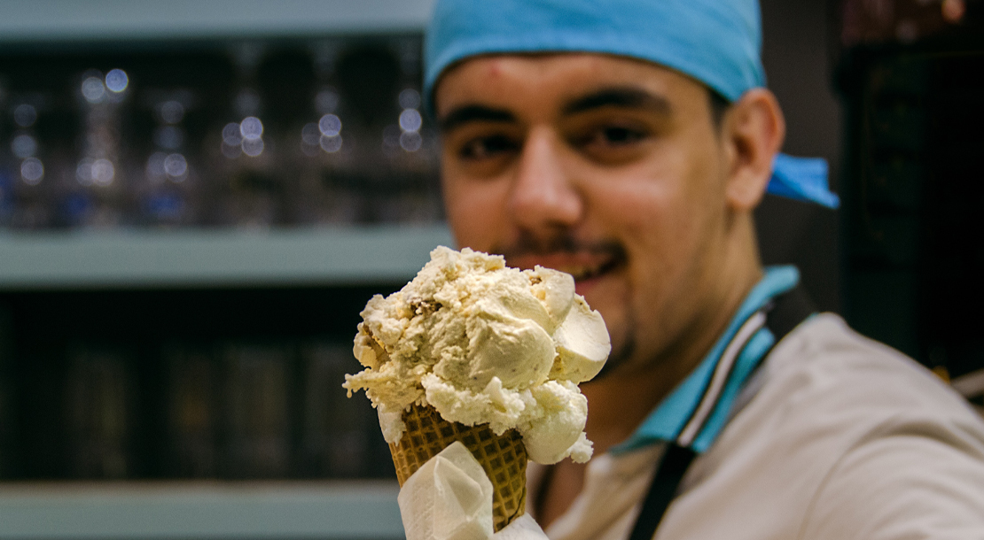 Image of man serving Ice Cream to illustrate improving your customer service gets you noticed