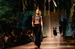 a-model-walks-the-ramp-displaying-an-outfit-by-397703