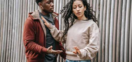 frustrated multiethnic couple having argue on street