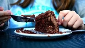 Kid eating a chocolate cake