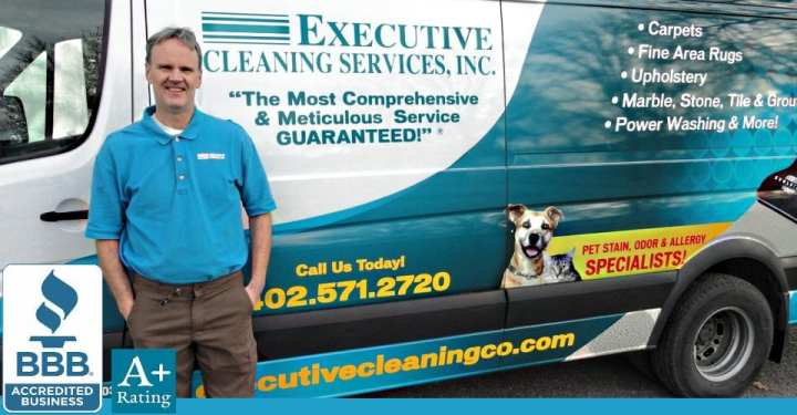 Owner of Executive Cleaning Services, Inc. posing next to work vehicle