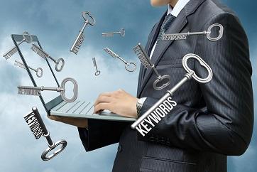 Keywords dials businessman on computer .