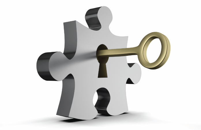Puzzle piece with key in keyhole