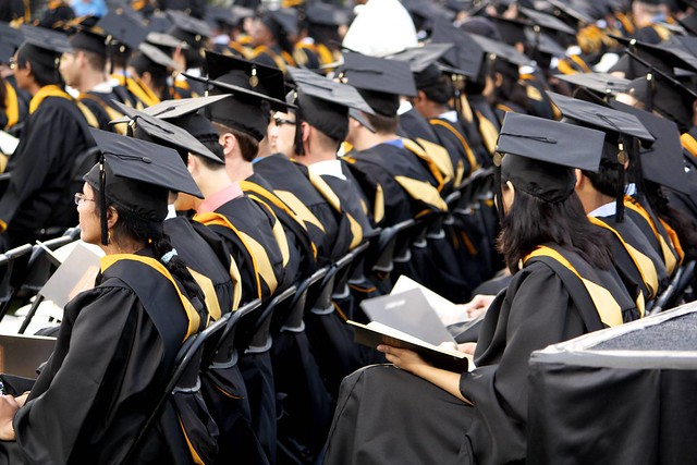 graduations sat in rows in their black cap and gowns