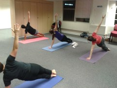 Girlguiding staff practicing Pilates in their office