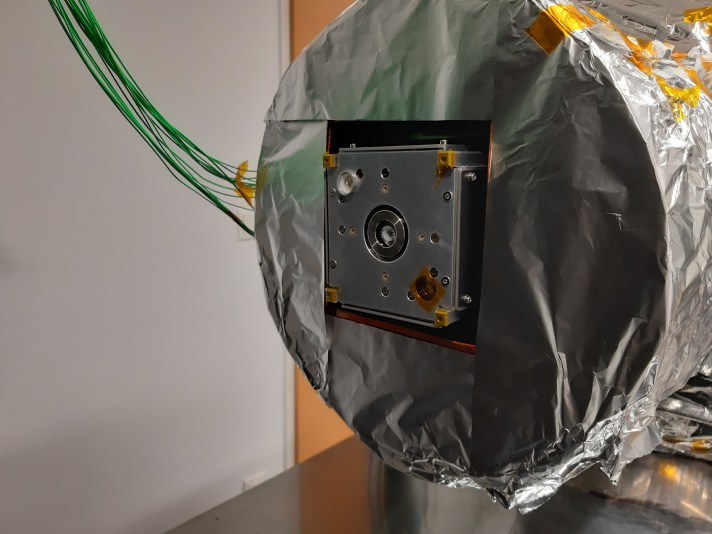 Physical thermal model with functional thruster in the thermal vacuum chamber.