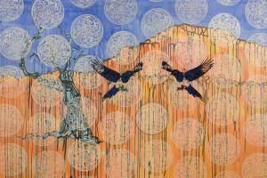 Birds hover near a tree