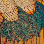 Close up of rhinestone accents in tail feathers