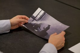 An attendee holds a print-out of a photograph by Allen Frame at Crosslisted: Dangerous Connections.
