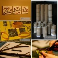 Cuadro otoñal con rollos de papel y ramas