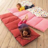 Colchoneta auxiliar con almohadas