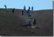 group of people going up Inferno Cone, Craters of the Moon National Monument and Preserve