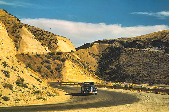 Road cut into the barren hills which lead into Emmett, Idaho - Photographer: Lee Russell, July 1941