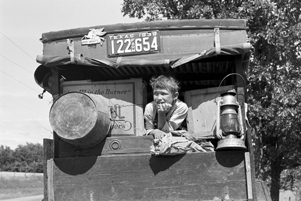 White migrant child sitting in back seat of family car east of Fort Gibson, Muskogee County, Oklahoma