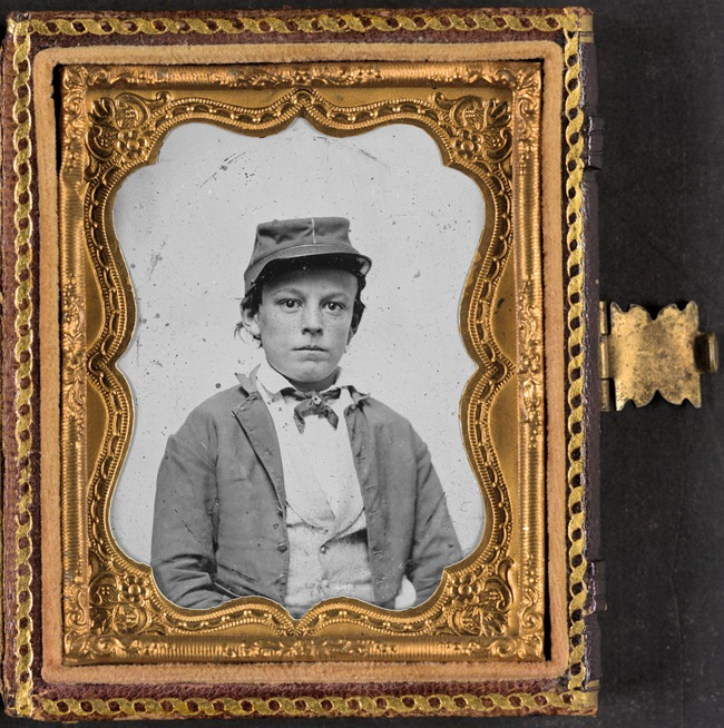 Unidentified young soldier in Confederate infantry uniform, possibly drummer boy
