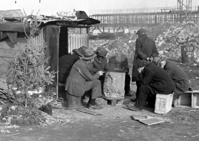Unemployed workers in front of a shack with Christmas tree 8a22559a