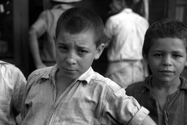 Children begging for pennies in the market in Rio Piedras, Puerto Rico; photo by Jack Delano