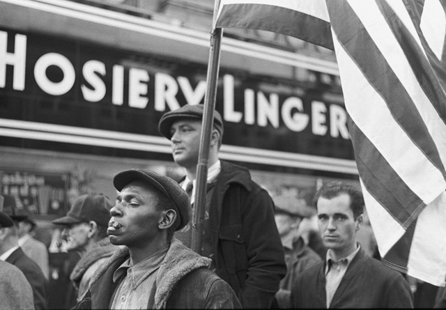 Watching Armistice Day parade, Omaha, Nebraska; photographed by John Vachon