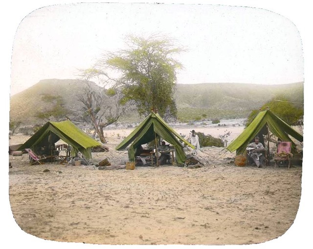 Camp, three tents with expedition members inside, Somalia, 1896