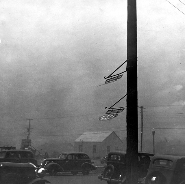 Dust storm. Note heavy metal signs blown out by wind. Amarillo, Texas