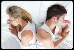female-sexual-problems-s3-photo-of-troubled-couple-lying-in-bed