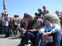 12. a Muslim woman with her husband for the prayer with the pope at noon