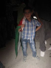 06. a little boy with a Palestinian flag