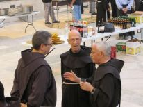 03. two friars talking with the Custos (l)