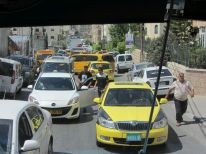 16. crowded at the Bethlehem side of the check point