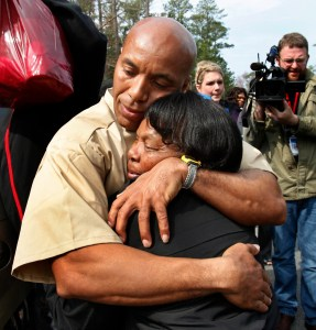 Thomas Haynesworth embraces his mother, Delores Haynesworth, after he was released from the Greensville Correctional Center in Jarratt, Virginia, March 21, 2011.