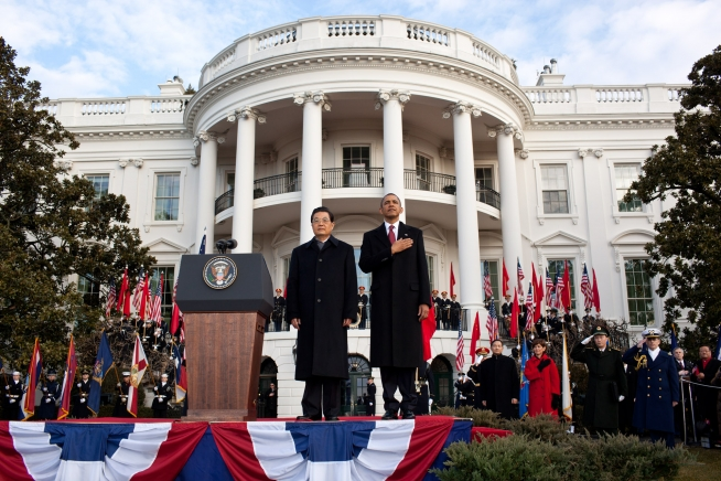 President Barack Obama and President Hu Jintao of China stand together during the playing of the national anthem on the South Lawn of the White House, Jan. 19, 2011. Credit: White House