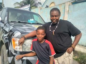 Isaac Utere offers help to hawker
