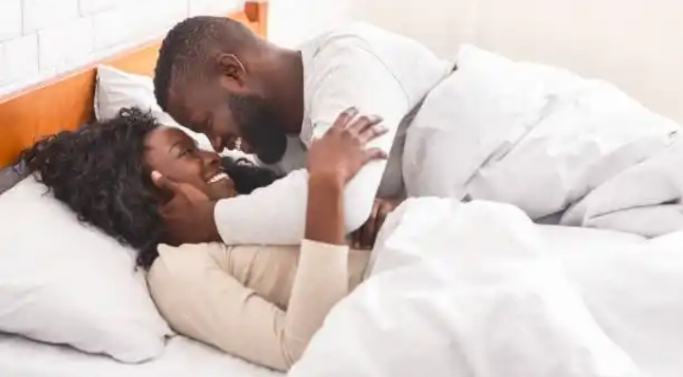 Lady recalls how the Holy Spirit woke up her Husband after he slept off without kissing her 'Goodnight'