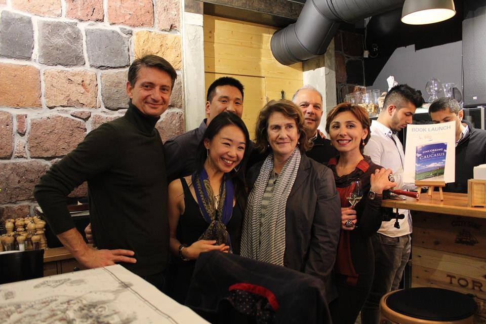 Us posing for a picture during a book signing at Wine Republic with the brains behind the Armenian Tree Project.