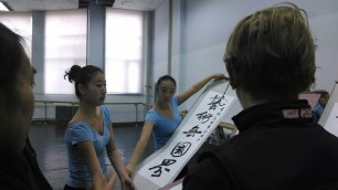 Students and staff of Changchun University present OSU 2014 China Tour participants a hand-made gift. Photo by Leisa DeCarlo.