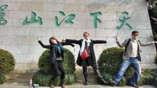 Kelly Hurlburt and Susan Petry embody Chinese characters at Yellow Crane Tower. Photo by Leisa DeCarlo.