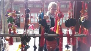 Susan Petry looking at souvenirs at Yellow Crane Tower. Photo by Leisa DeCarlo.