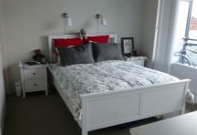 Bed, lamps, and bedside tables