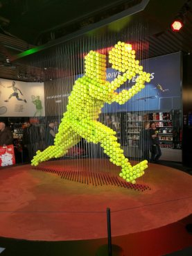 """A clever display in the Peugeot showroom celebrating their """"Drive to Tennis"""" campaign"""