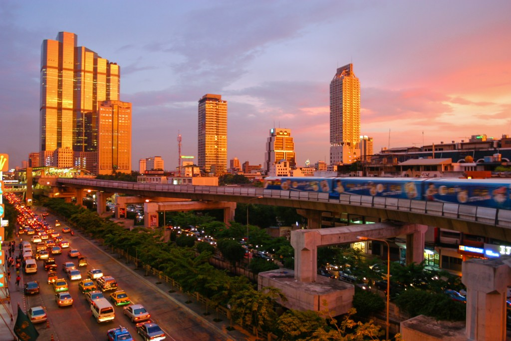 sunset in Bangkok, showing the skytrain and modern skyline down Thanon Naradhiwas Rajanagarindra, taken from the corner of Thanon Silom, with the Empire Tower and the Chong Nonsi BTS Station at the left side - FATCA Workshop for Expats