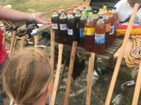 Axes and motor oil in pop bottles.